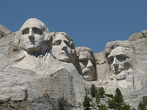 Mount Rushmore. Four faces were carved out of solid rock. It was caused by a process of time and chance
